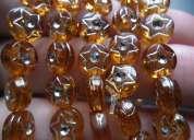 Pulseiras de na cor caramelo com estrela prateada