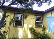 Terreno 10x15 com casa de madeira troco por casa em guaratuba