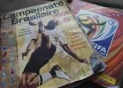 2 álbuns de figurinhas completos (brasileirão 2005 e copa do mundo 2010)