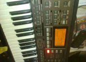 Vendo ou troco roland exr5s com capa  de partitura disketi ritmo forró e preibeque