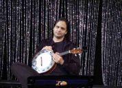 Aulas de violão e guitarra com integrante da orquestra do musical cabaret.