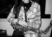Professora de saxofone, musicalização infantil e teoria musical